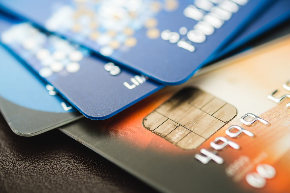 Image showing 4 credit cards in a pile.